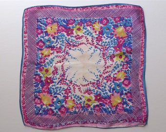 Handkerchief, vintage.   The design is a riot of flowers in shades of purples blues & yellows, silk. c1930's.