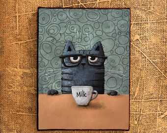 cat with milk cup