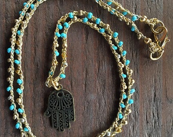 Blue and Gold Seed Beaded Necklace with a Copper Hamsa Pendant