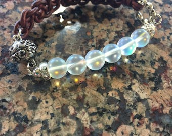 Half leather, half genuine natural moonstone on silver wire, with magnetic clasp, this style is so comfortable, you'll forget its on!