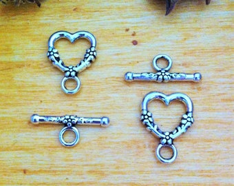 decorated with flowers, antiqued silver tone heart shape 4 toggle clasps