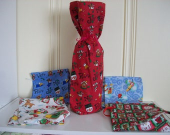 Wine Bottle gift wraps,In Christmas assorted prints,Sets of 3,5, or 10 .Prints may vary per order.