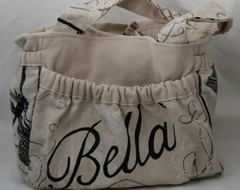 Chic Bella diaper bag/multi use bag with pockets and pouches galore