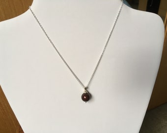 "A Burgundy Swarovski Pearl Pendant on a Sterling Silver Pendant Bail on a Sterling Silver 16 to 18"" Cable Chain"