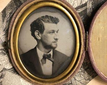 Tintype of man in photo case