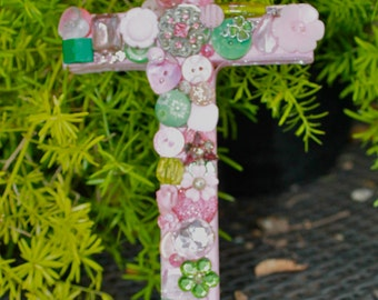 Trinket covered cross