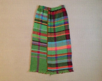 1960's, colorful, woven, maxi skirt, with fringe bottom and a beaded sripe down front and back