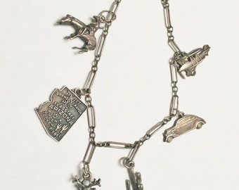 simple old sterling charm bracelet, western and transportation themed