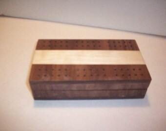 Handmade travel cribbage board, including playing cards and pegs.