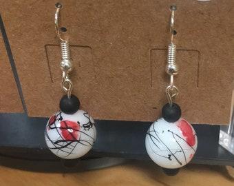 Red and black splatter earrings