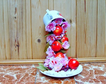 Decoration of flowers and apples cascading