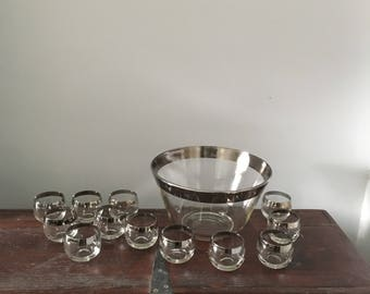 set of dorothy thorpe rocks glasses and punch bowl. silver glasses. mad men 1960s barware. silver rimmed glassware. mid century modern.