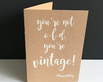 You're VINTAGE. Birthday. Birthday. Congratulations! Greeting card of Kraft carton with white ink. With envelope.