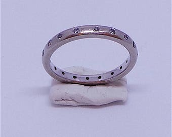 Lovely 18 carat white gold engagement/eternity ring with diamonds