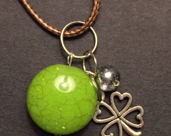 Green bead and clover pendant cord necklace