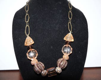 Super cute Chunky Gold and browns necklace with two matching beaded bracelets