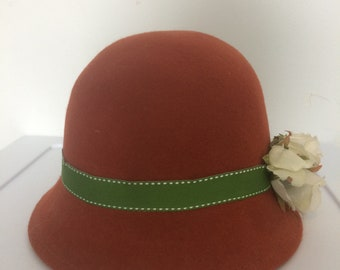 Burnt orange cloche hat with white roses