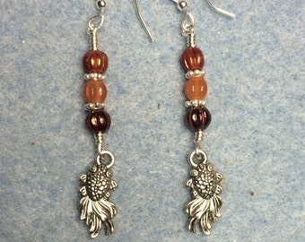 Small silver goldfish charm dangle earrings adorned with small orange Czech glass beads.