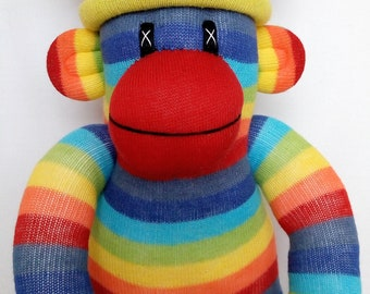 Rainbow Sock Monkey with striped pom pom hat