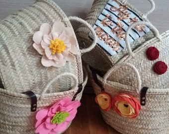Basket or carrycot of beach decorated with flower, traditional handicraft