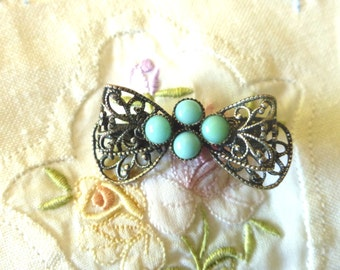 Filigree Bow with turquoise accents