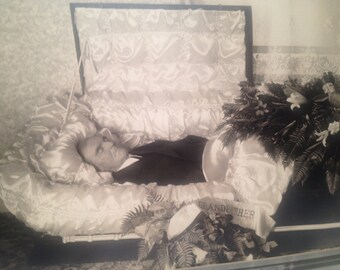 Post-mortem photo, man in casket c. 1940