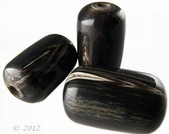Old stock buffalo horn barrels, 28x17mm, package of 4. b3-ho17(e)
