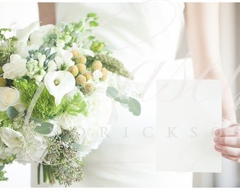Horizontal image of bride holding 5x7 invitation stationery card stock photo mockup