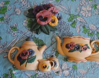 Set of 3 plastic tea pot, creamer and sugar with flowers and teapot wall pocket by Burwood products