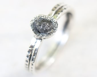 Dark gray rough diamond ring in silver bezel setting with sterling silver texture oxidized double band