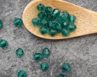 Glass beads, beads faceted 4 mm, dark green, glass spacer beads