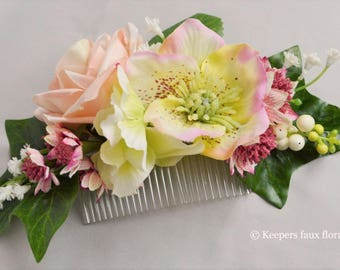 Faux Floral hair comb in shades of pink and green