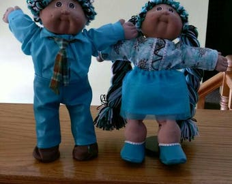 Twin boy and girl Cabbage Patch Kids. Reroot in chocolate, teal and white.