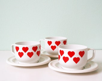 Cups with red hearts, saucer and sugar bowl, children's toy