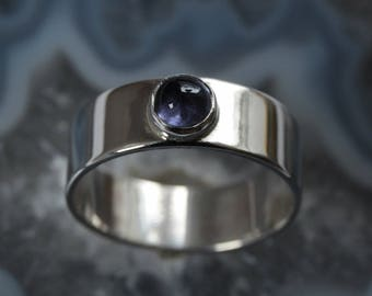 Silver ring with blue iolite - US size