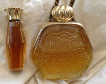 Two Vintage unique perfume bottles, one unknown mysterious