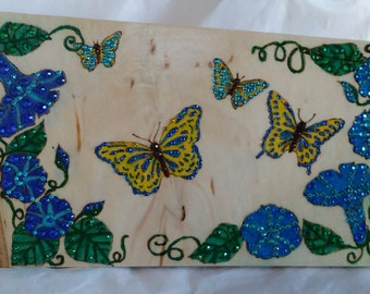 Butterflies and flowers wood burned, painted and embellished with colored crystals blue morning glories,  yellow and blue butterflies