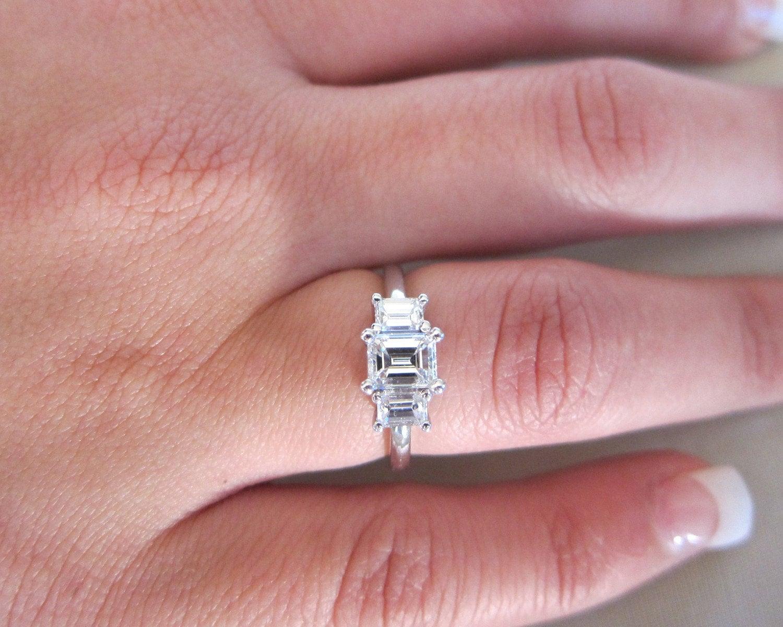 Three stones Emerald cut platinum engagement ring