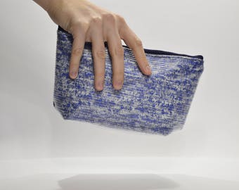 Blue and white pouch bag