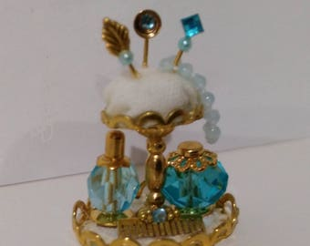 Jewerly in cake stand for miniature shop