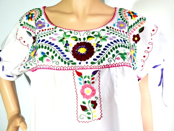 White bohemian dress with Mexican embroidery.