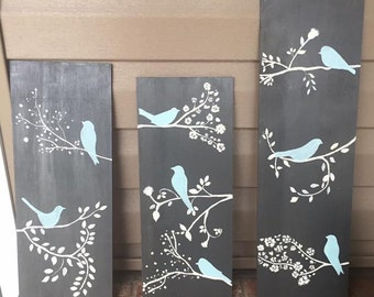 Blue birds on branches