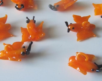 Set of 25 glass pendants in the shape of butterflies - orange and black