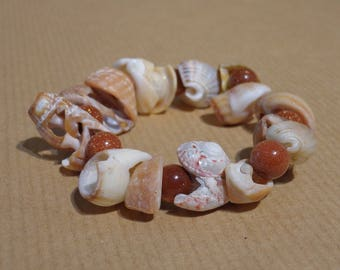 Bracelet beads and shells. Sun stones (glass and copper).