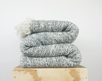 Boho bedding couch blanket cover in gray woven fluffy boucle yarn