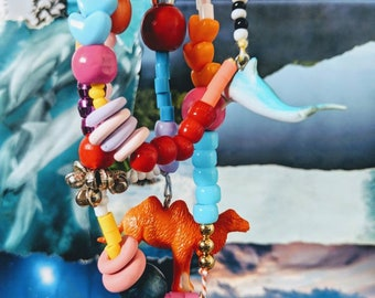 Plastic Animal Necklace with Crazy Bead Action