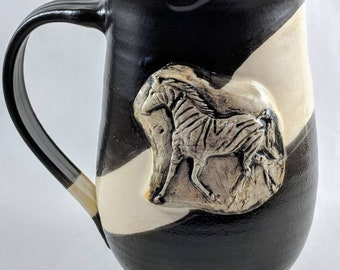 Pottery coffee mug,  approximately 16 oz handmade ceramic mug with black and white glazes featuring a zebra