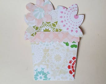 The card in the shape of flowers in its pot
