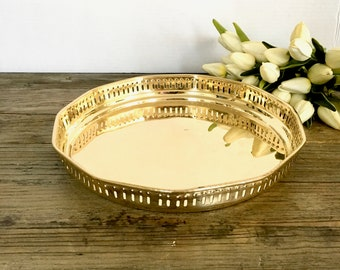 Round Brass Serving tray with cutout edging and floral handles