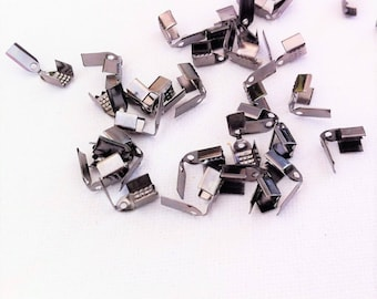 40 caps form clip, black flaps for ties, 9x4mm